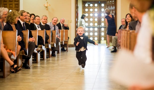 Smiling boy to the altar