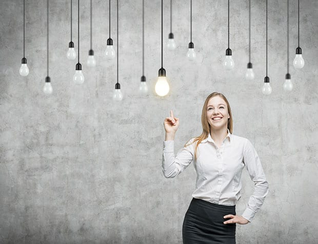Woman pointing at lightbulb