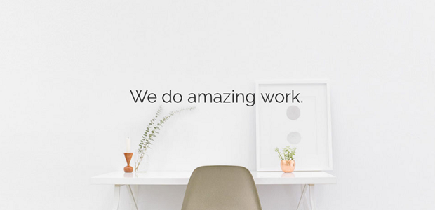 A neat white desk with sleek text reading 'We do amazing work.'
