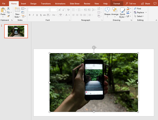 A photo of a held out smartphone, open in Microsoft Powerpoint