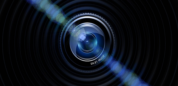 A close-up image of a camera zoom lens