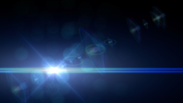 A bright lens flare against an empty, dark background