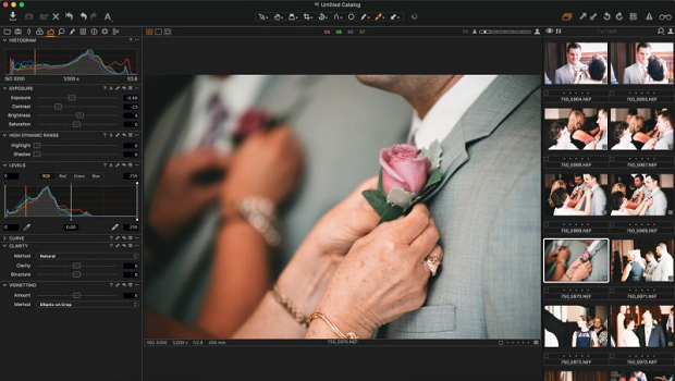 An image of a woman pinning a rose to a man's suit, loaded into the Capture One interface