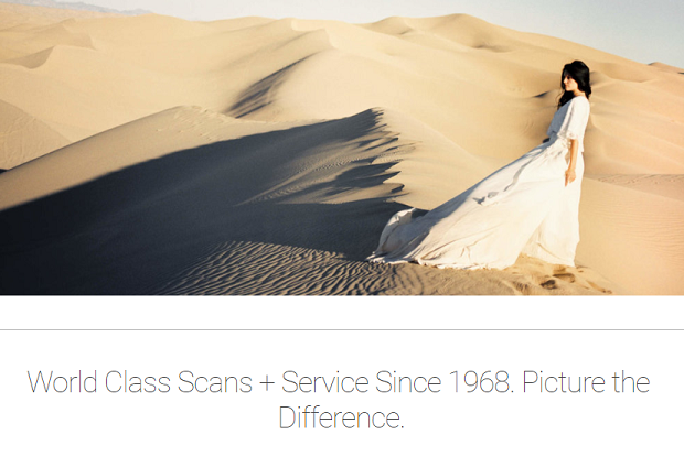 Photovision's homepage, with a woman standing in the middle of the desert in a flowing dress
