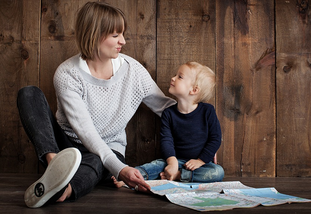 A mom and her son looking over a map together