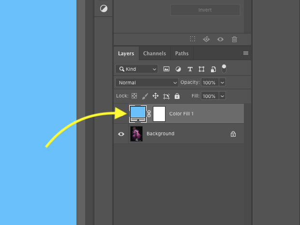 Close up of Photoshop's layers panel with one locked background image and one solid adjustment layer with layer mask. Yellow arrow pointing to solid blue layer.