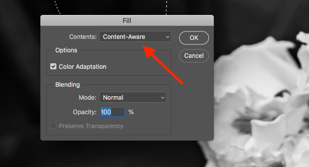 """Fill"" dialog box open in Photoshop with red arrow pointed at ""Content-Aware"" contents option."
