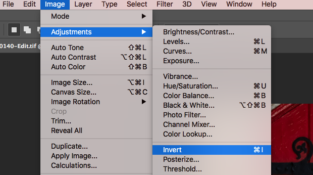 """Invert"" option selected from ""Adjustments"" under Photoshop's ""Image"" toolbar option"