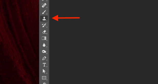 Red arrow pointed to Photoshop's Clone Stamp Tool icon in left-hand panel