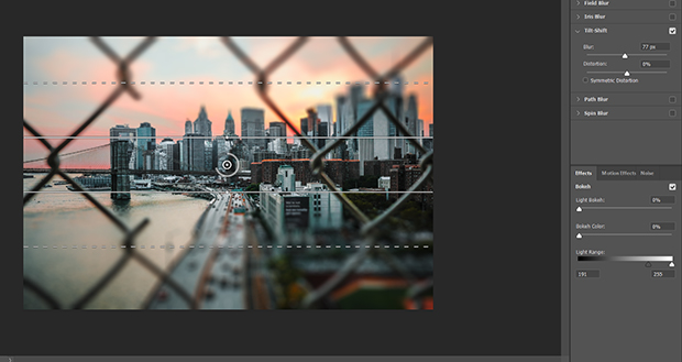 Blur filter applied to cityscape photo in Photoshop