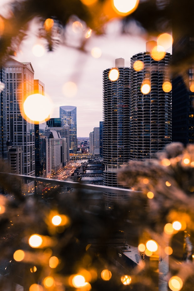 Skyscrapers of city scene visible through close-up glare of outdoor lights