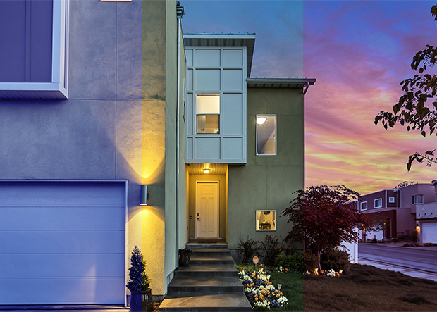 Home exterior with fluorescent lighted door and beautiful sunset sky in the background