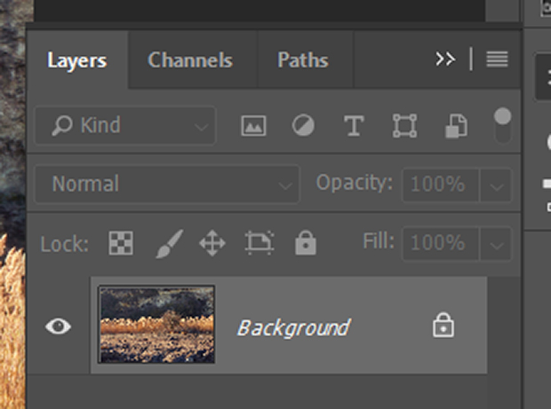 Layers panel in Photoshop with locked background layer of original image