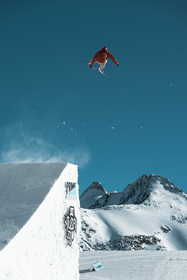 Sports event photography of a snowboarder doing a trick